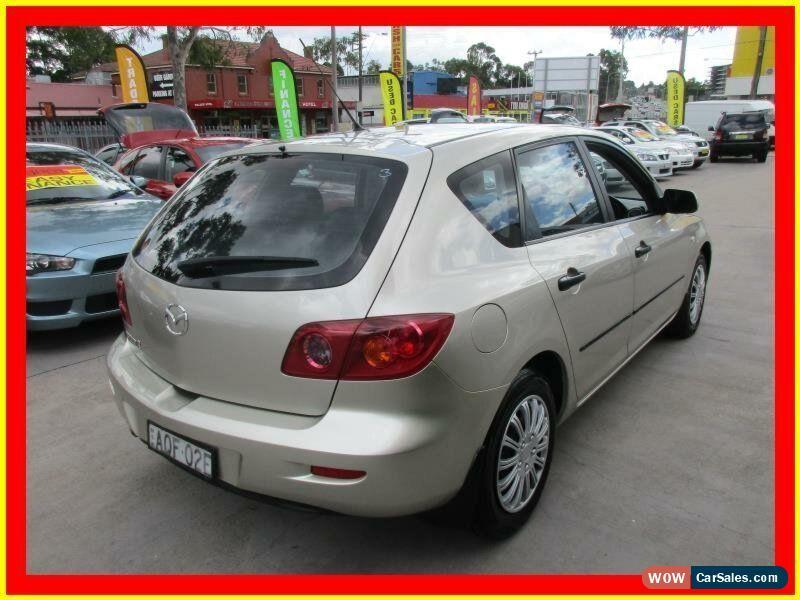... Classic 2004 Mazda 3 BK10F1 Neo Gold Manual 5sp M Hatchback For Sale
