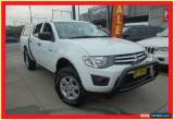 Classic 2010 Mitsubishi Triton MN MY11 GLX White Manual 5sp M 4D Utility for Sale