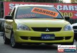 Classic 2007 Mitsubishi Lancer CH MY07 ES Yellow Manual 5sp M Sedan for Sale