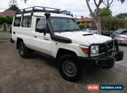 2013 Toyota Landcruiser VDJ78R MY12 Update Workmate (4x4) 11 Seat White Manual for Sale
