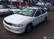 1998 Mitsubishi Lancer CE GLi White Automatic 4sp A Sedan for Sale