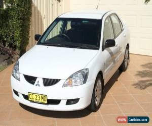 Classic 2005 Mitsubishi Lancer CH MY06 ES White Manual 5sp M Sedan for Sale
