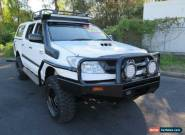 2010 Toyota Hilux KUN26R MY10 SR White Manual 5sp M 4D UTILITY for Sale