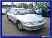 1994 Ford Telstar AX Ghia Silver Automatic 4sp A Sedan for Sale