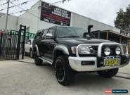 2004 Toyota Hilux KZN165R SR5 (4x4) Black Manual 5sp M Dual Cab Pick-up for Sale