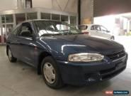 2000 Mitsubishi Mirage CE Blue Manual 5sp M Hatchback for Sale