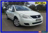 Classic 2009 Suzuki SX4 GY White Automatic 4sp A Sedan for Sale