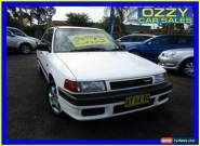 1990 Mazda 323 Astina White Manual 5sp M Sedan for Sale
