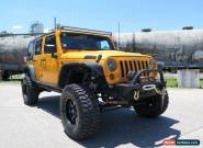 2012 Jeep Wrangler JK MY2012 Unlimited Sport Orange Manual 6sp M Softtop for Sale