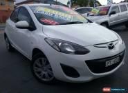 2012 Mazda 2 DE MY13 Neo White Manual 5sp M Hatchback for Sale