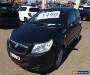 Classic 2009 Holden Barina TK MY09 Black Manual 5sp M Hatchback for Sale