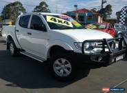 2013 Mitsubishi Triton MN MY13 GLX (4x4) White Manual 5sp M Dual Cab Utility for Sale