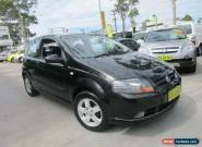 2005 Holden Barina TK Black Automatic 4sp A Hatchback for Sale