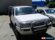 FORD COURIER TWIN CAB 05/2004 TURBO DIESEL 4WD STEER AND AIR TABLETOP WITH SIDES for Sale