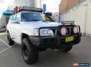 2011 Nissan Patrol GU 7 MY10 ST White Manual 5sp M Wagon for Sale