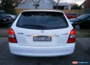 2001 Mazda 323 Astina White Automatic 4sp A Hatchback for Sale