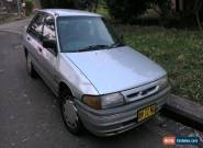 Ford Laser Ghia (1991) 5D Hatchback Automatic (1.8L - Electronic F/INJ) Seats for Sale
