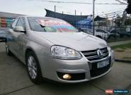 2010 Volkswagen Jetta 1KM MY10 118 TSI Silver Automatic 7sp A Sedan for Sale