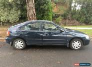 Ford Laser GLXi (1999) 5D Hatchback Manual (1.8L - Multi Point F/INJ) Seats for Sale